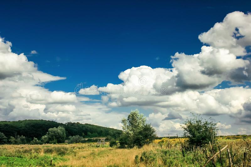 Amazing clouds on blue sky and country side, beautiful summer na. Ture landscape royalty free stock images