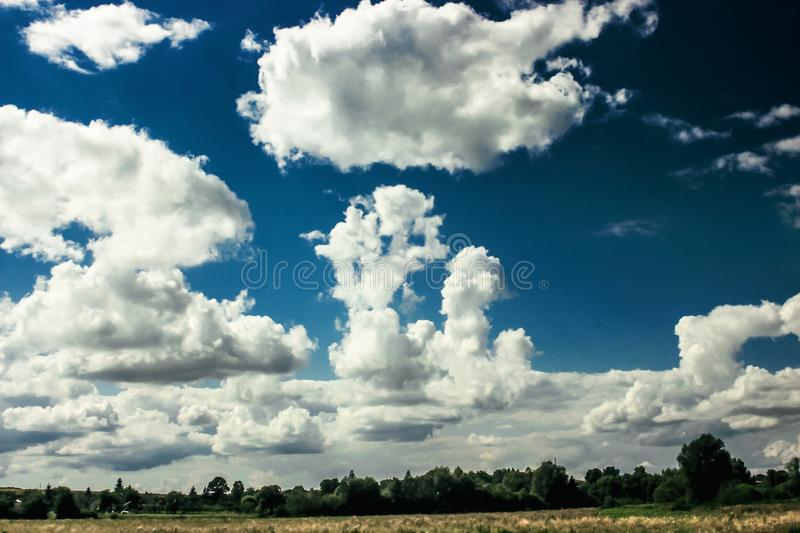 Amazing clouds on blue sky and country side, beautiful summer na. Ture landscape stock photos