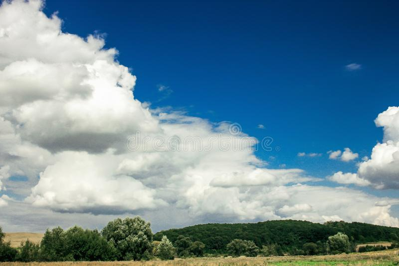 Amazing clouds on blue sky and country side, beautiful summer na. Ture landscape stock photo