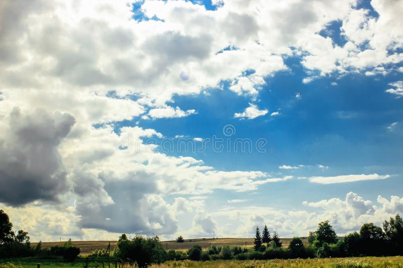 Amazing clouds on blue sky and country side, beautiful summer na. Ture landscape stock images