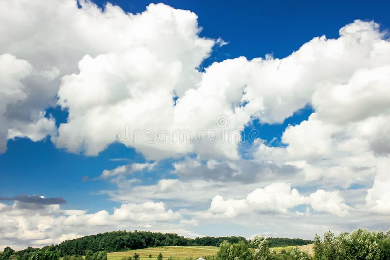 Amazing clouds on blue sky and country side, beautiful summer na. Ture landscape royalty free stock image