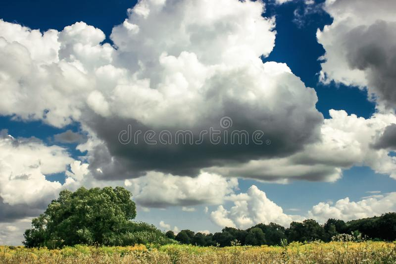 Amazing clouds on blue sky and country side, beautiful summer na. Ture landscape royalty free stock photography