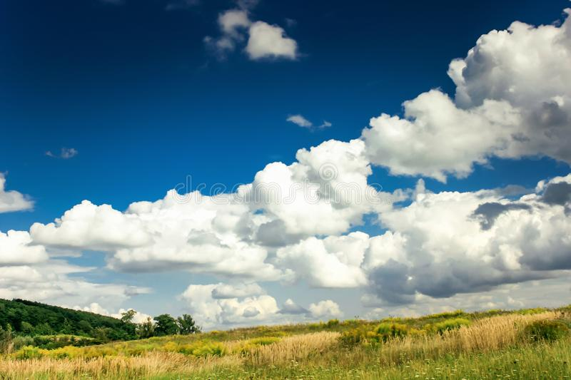 Amazing clouds on blue sky and country side, beautiful summer na. Ture landscape stock photography
