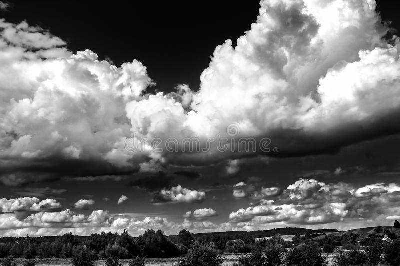 Amazing clouds on sky and country side, beautiful summer nature. Landscape, black and white stock photos