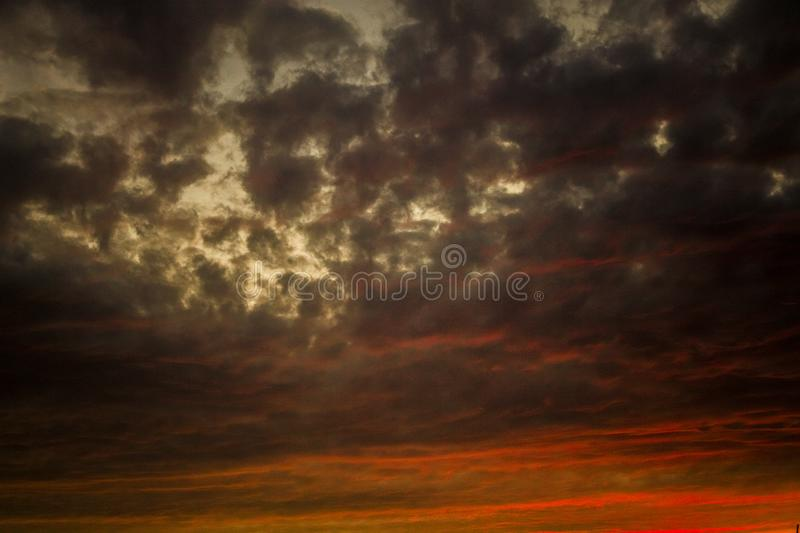Amazing colored clouds orange and gray royalty free stock photos