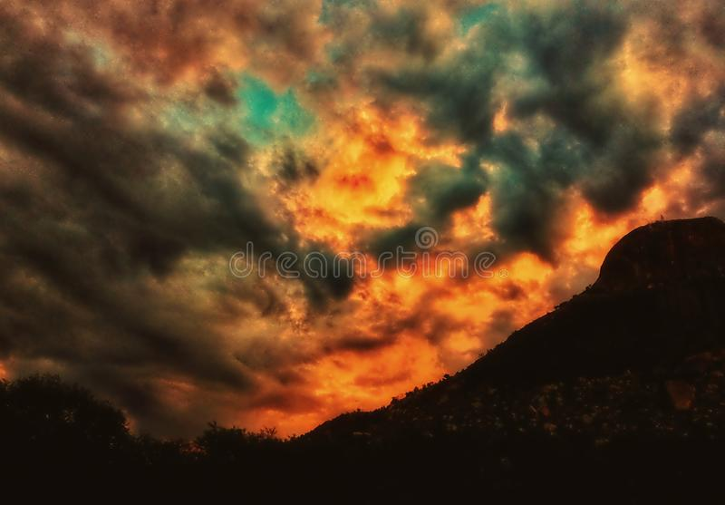Amazing sunset sky over the hill royalty free illustration