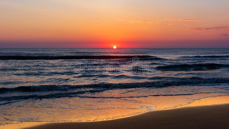 Amazing colorful dawn at sea royalty free stock images