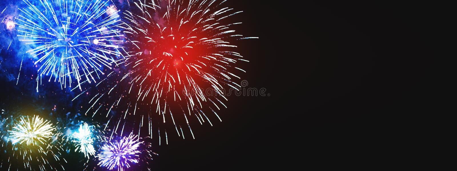 Amazing colorful firework background with free space for text. B stock photo