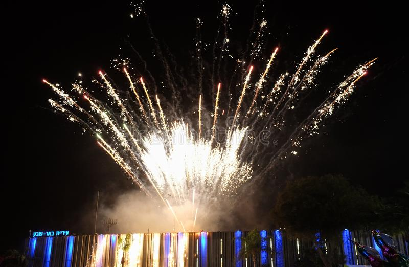 Amazing colorful fireworks at Independence Day above City Hall of Beer-Sheva. On left side written 'Beer-Sheva ' in hebrew letter royalty free stock photo