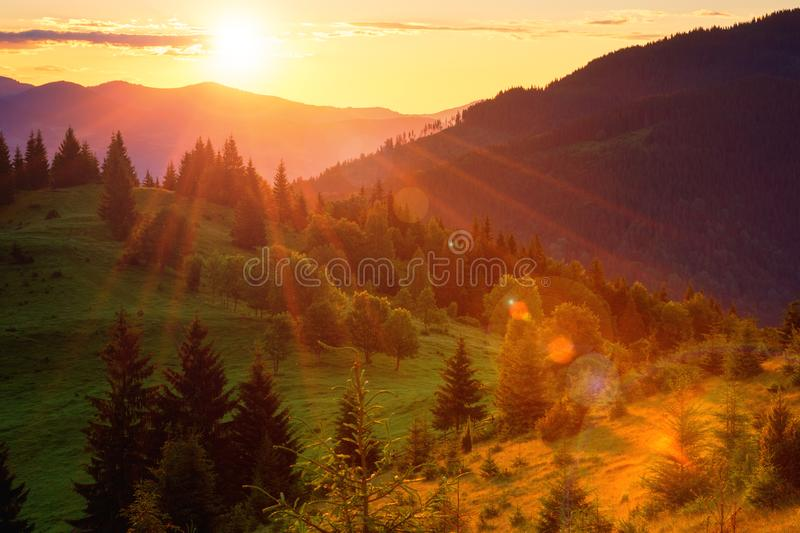 Amazing colors of sunset in the mountains, nature summer landscape. With sun and magic sunlight, travel background stock photos