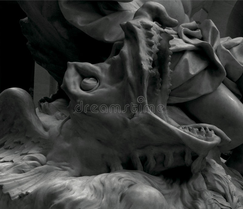 The amazing creature. Shot in black and white, detail on a sculpture representing a strange monster, placed on the museum, set in New York City, USA, America stock photos