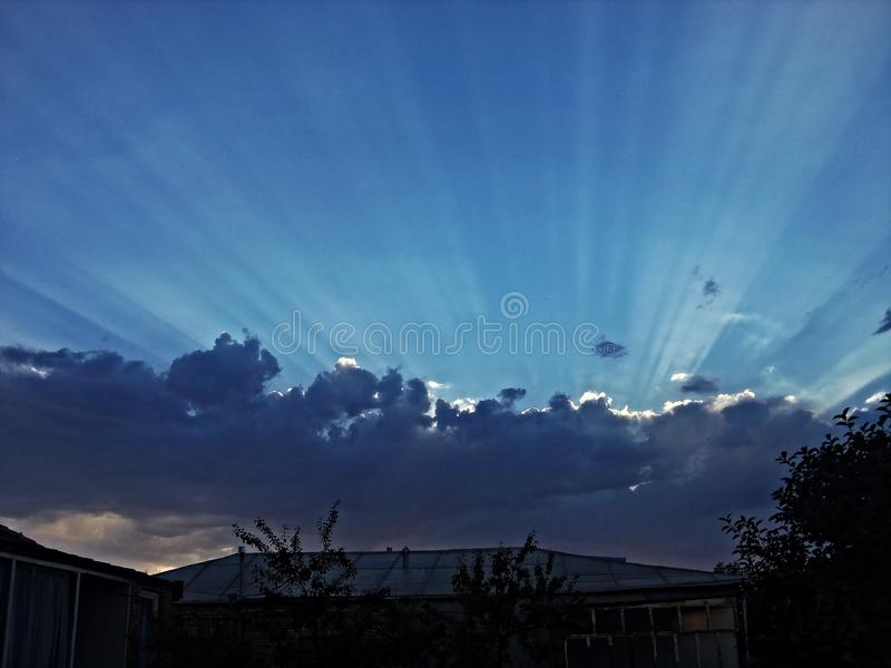 Pleasant view. dark clouds and sunset. royalty free stock photo