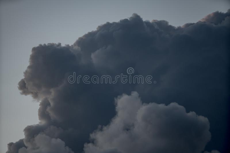 Amazing dark storm weather clouds shot with a telephoto lens stock photos