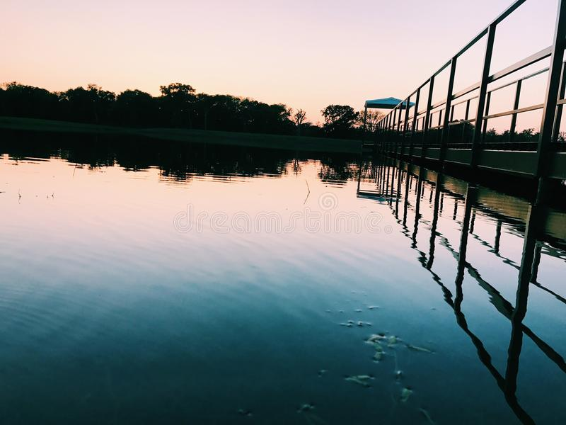 Amazing dock perspective. With sunset royalty free stock photography