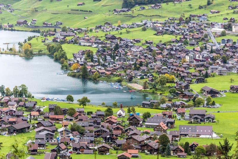 Amazing dream like Swiss alpine mountain landscape. Wooden chalets on green fields in Lungern of Switzerland stock photography