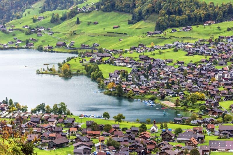 Amazing dream like Swiss alpine mountain landscape. Wooden chalets on green fields in Lungern of Switzerland stock photo