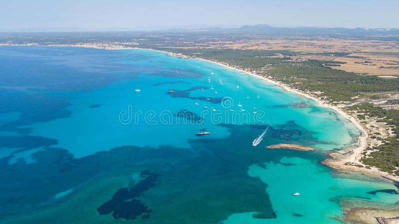 Amazing drone aerial landscape of the charming beach Es Trencs. It has earned the reputation of Caribbean beach of Mallorca. Spain stock photo