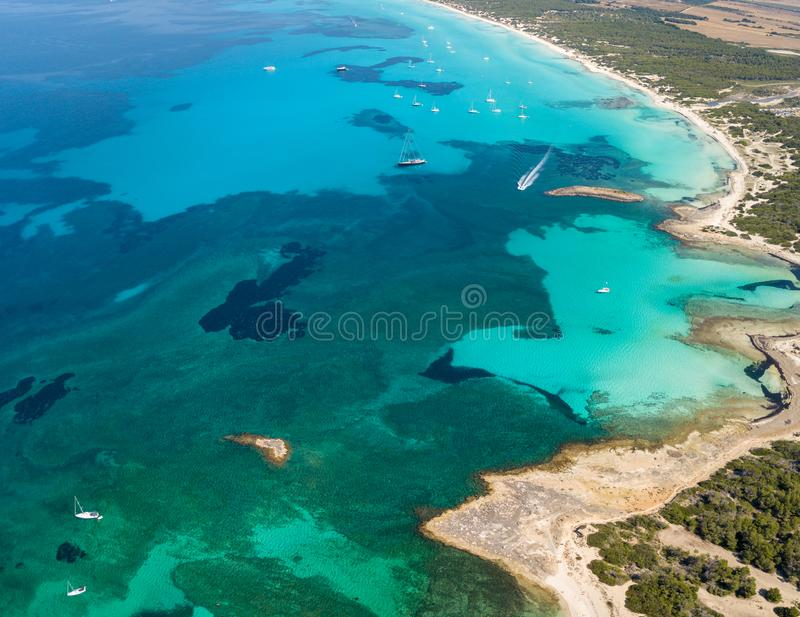 Amazing drone aerial landscape of the charming beach Es Trencs. It has earned the reputation of Caribbean beach of Mallorca. Spain royalty free stock photo