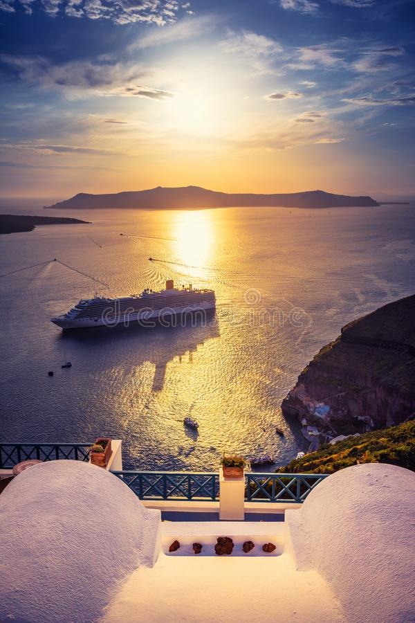Amazing evening view of Fira, caldera, volcano of Santorini, Greece with cruise ships at sunset. royalty free stock photo