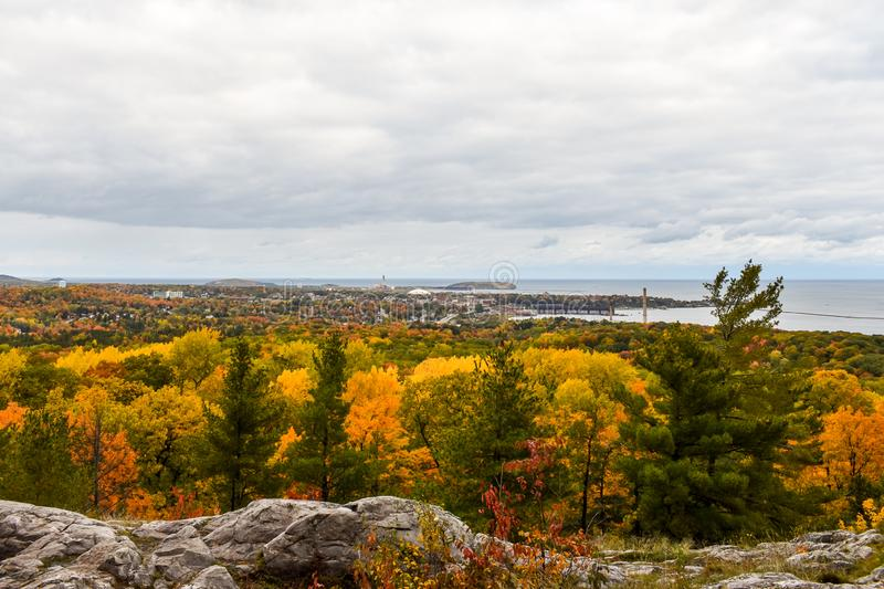 The City of Marquette, Michigan seen from Mount Marquette at Peak Autumn Colors. Amazing fall colors on top of Mount Marquette Michigan overlooking the City of royalty free stock images