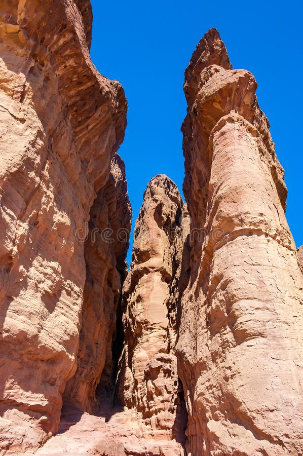 Amazing famous Solomon Pillars ancient high rocks cliffs with narrow ravines in Timna National Park in Aravah valley desert in stock image