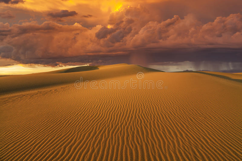 Amazing fiery rain clouds over the Gobi desert. Mongolia royalty free stock photography