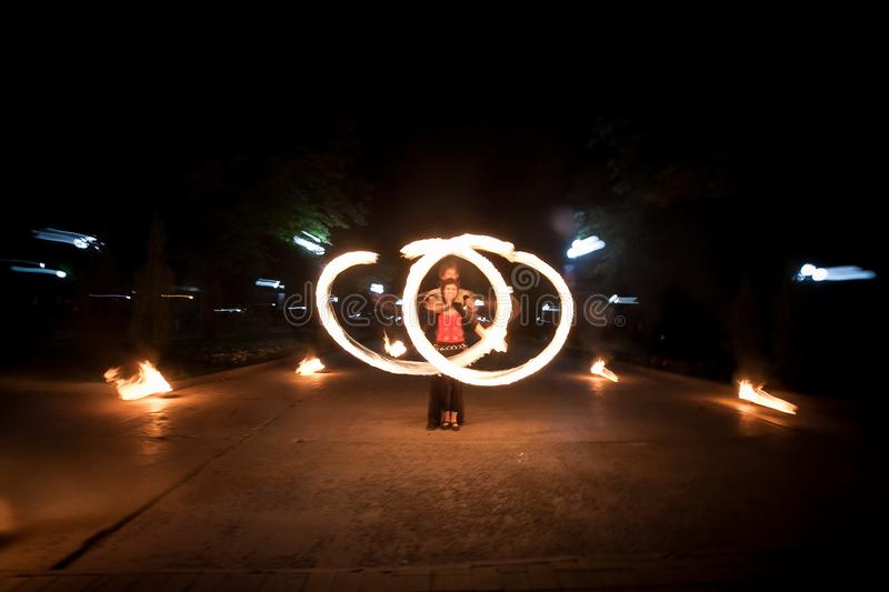 Amazing fire show dance. Fire dancers playing with flame. Butterfly figure stock images