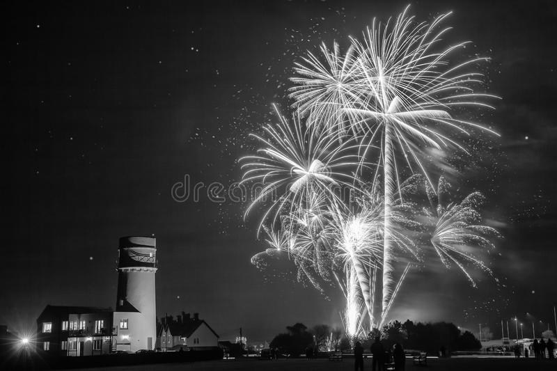 Amazing fireworks at night over lighthouse stock photography