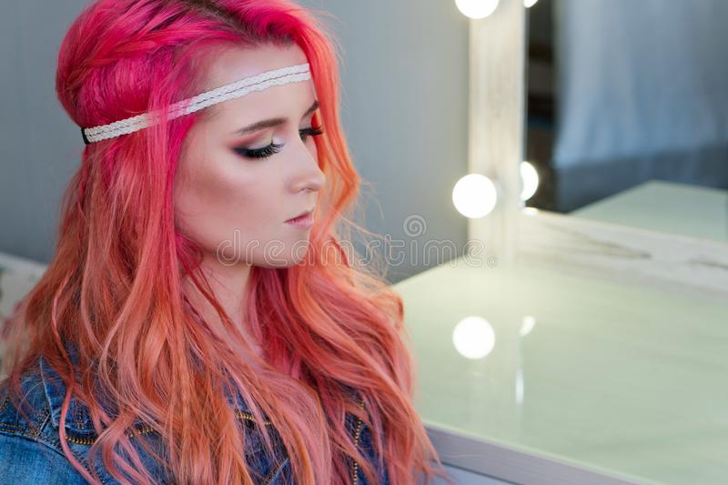 Trendy rich color hair. Amazing free mallow pink color for trendy hairstyle hippie girl. Bohemian, bo-ho style. Space for text. Bright colors. Party image stock photo