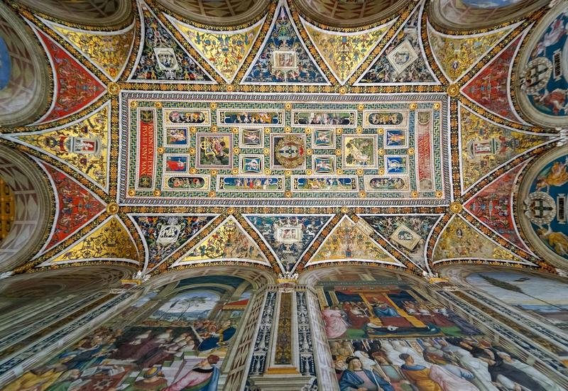 Painting on the ceiling in Piccolomini Library in Siena Cathedral, Italy stock photos