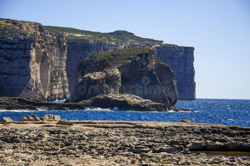 Amazing Fungus and Gebla Rock cliffs in the Dwejra Bay beach near collapsed Azure window, Gozo island, Malta. Amazing Fungus and Gebla Rock cliffs with Rocky stock images