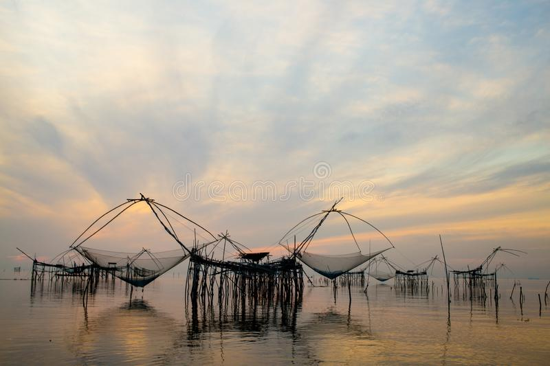 Amazing giant fish lift net with sunrise in Pakpra canal,Phatthalung,Thailand royalty free stock photography