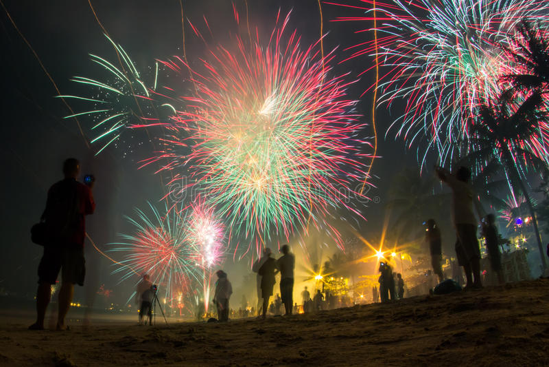 Amazing glorious fireworks on the beach royalty free stock photo