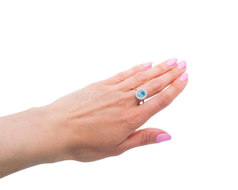 Amazing golden ring with topaz and few diamonds on woman`s hand royalty free stock photography