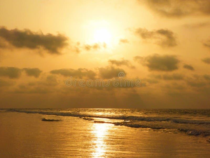 An amazing golden sunrise view at beach stock photo