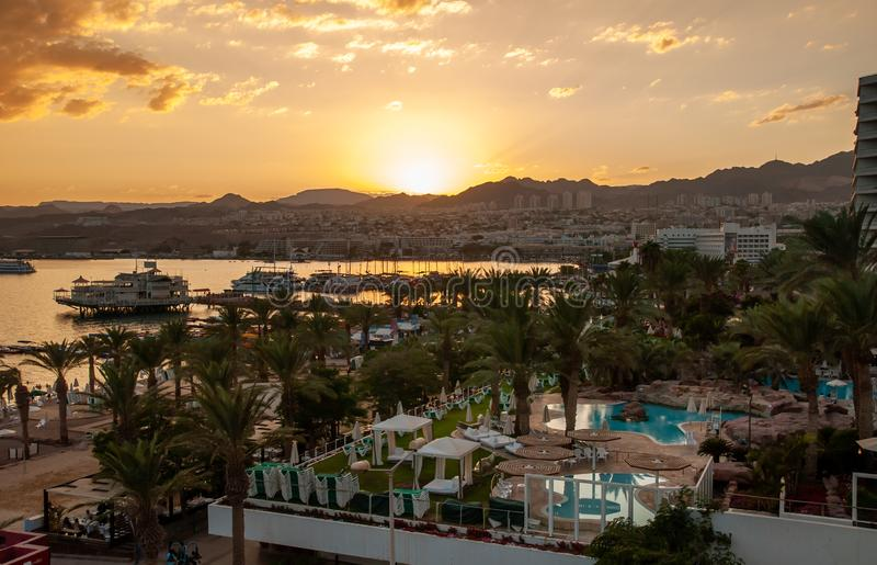 Amazing golden sunset at Eilat Red Sea bay. EILAT, ISRAEL - SEPTEMBER 24, 2011: Amazing golden sunset at Eilat Red Sea bay stock images