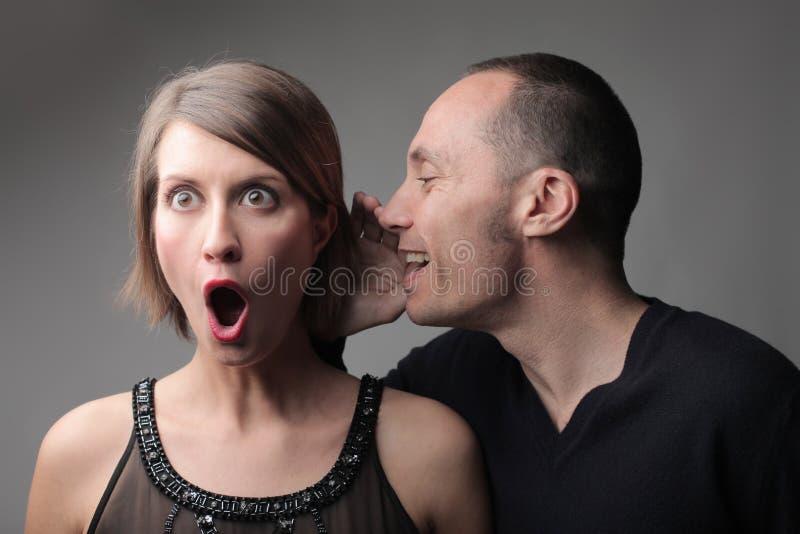 Amazing gossip. Man telling an astonished women a gossip