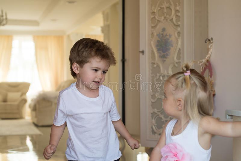Amazing hair beauty salon. Small children with stylish hairstyles. Small boy and girl with blond hair. Brother and royalty free stock images