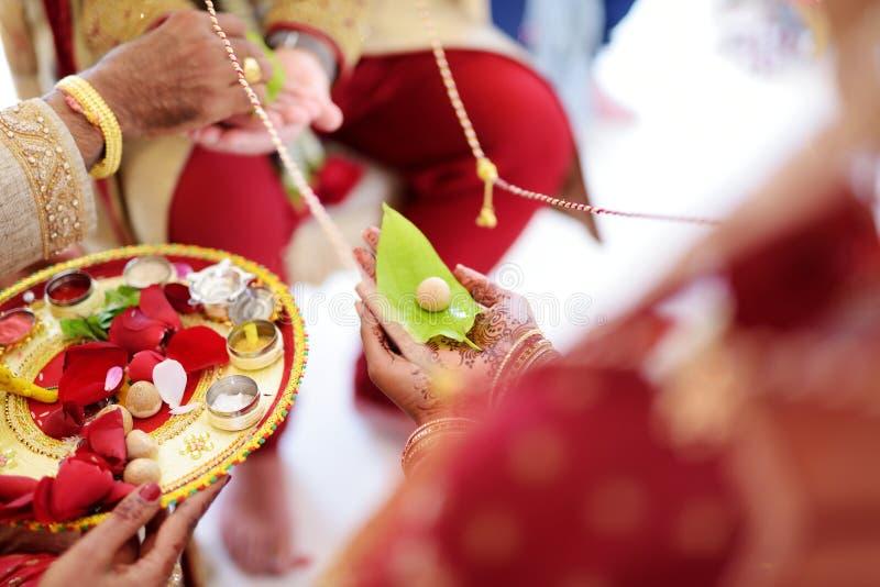 Amazing hindu wedding ceremony. Details of traditional indian wedding. Beautifully decorated hindu wedding accessories. Indian marriage traditions stock photo