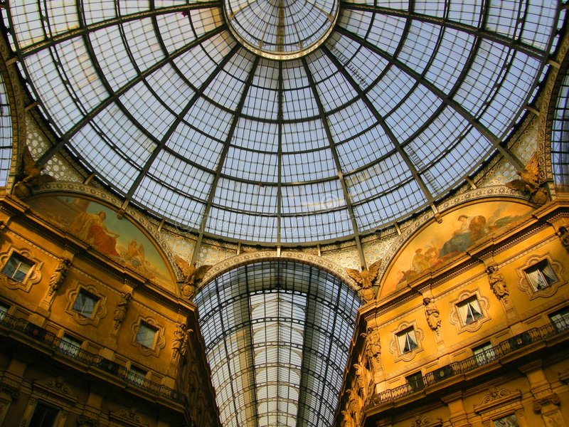 Amazing Italy Milan Galleria. Amazing perspective of Italian glass roof Galleria Vittorio Emmanuele high-fashion cool shopping centre Milan Italy royalty free stock photography