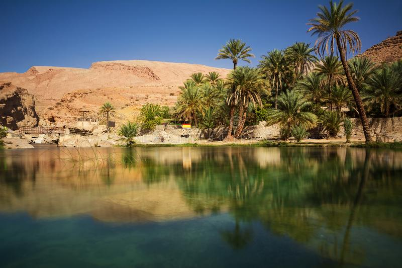 Lake and oasis with palm trees Wadi Bani Khalid in the Omani desert stock images