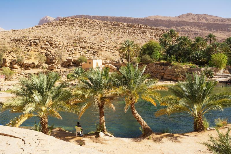 Amazing Lake and oasis with palm trees Wadi Bani Khalid in the desert stock photography