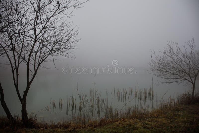 Amazing landscape of bridge reflect on surface water of lake, fog evaporate from pond make romantic scene or Beautiful bridge on l stock photography