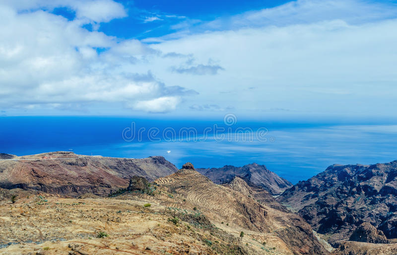 An amazing landscape from coastline of La Gomera, Canary islands. Boat in Atlantic ocean. royalty free stock images
