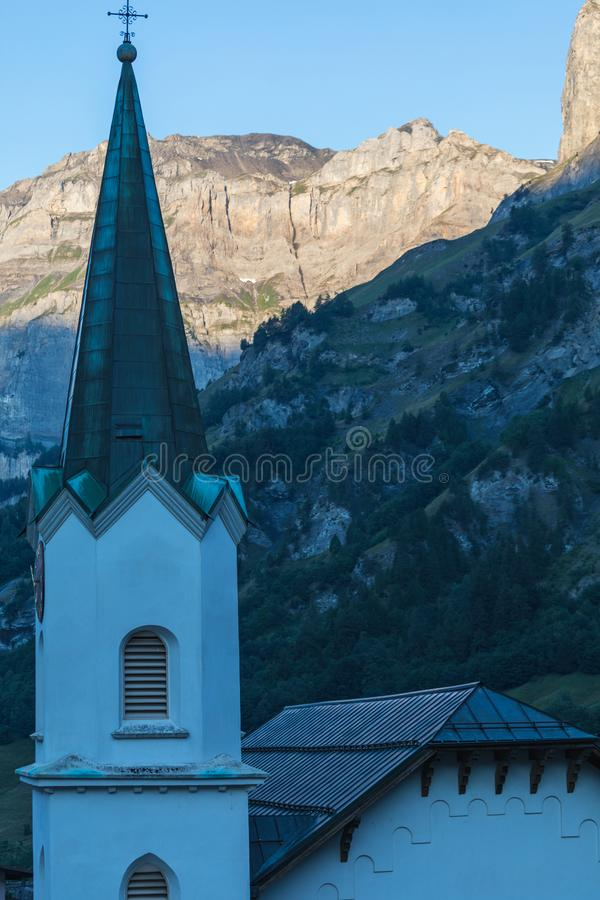 Amazing landscape of the Gemmi cliff, church in foreground in Sw stock photo