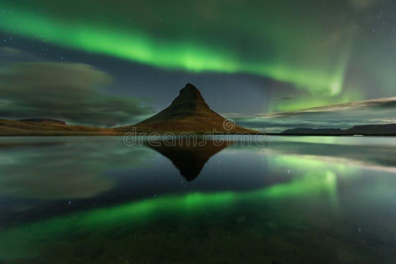 Amazing landscape with green bands of Aurora Borealis. Snaefellnes, Iceland stock photo