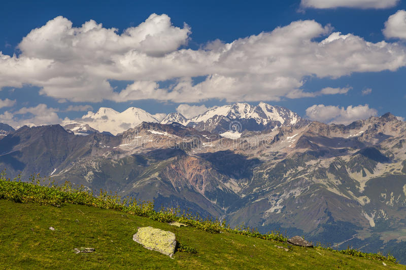 Amazing landscape with high mountains under the blue sky royalty free stock photos