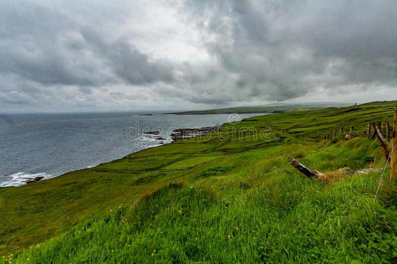 Amazing landscape of the Irish countryside and the sea along the coastal walk route. From Doolin to the Cliffs of Moher, Wild Atlantic Way, county Clare in royalty free stock images