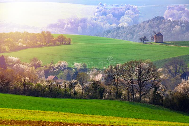Amazing landscape of moravian fields with old windmill in south Moravia, Czech republic. Rolling waving hills spring background stock photography