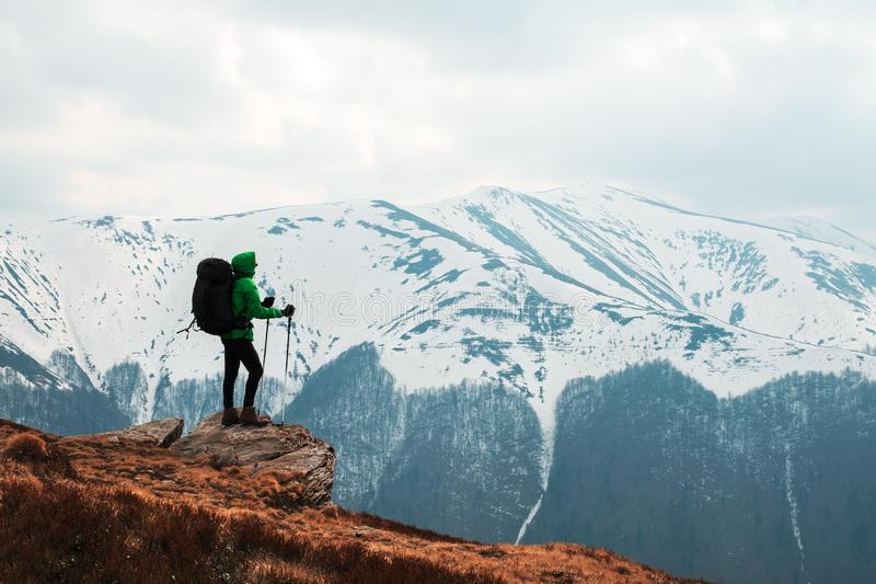 Amazing landscape with snowy mountains range. Amazing view with snowy mountains range and hiker with backpack on a foreground. Landscape photography royalty free stock images